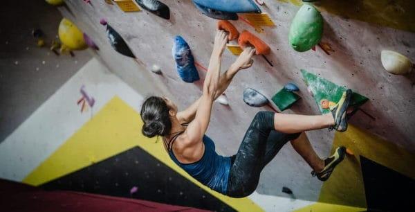 rock climbing woman on rock wall
